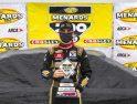 Сэм Майер празднует победу в сокращённой гонке в Толедо